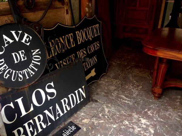 Antique signs at Passage 125 Marolles Brussels